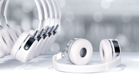 Headphone white color selective focus on abstract blurred background with copy space for your text.