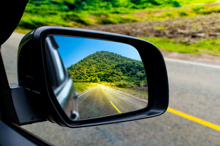 Landscape in the sideview mirror of a car , on road countryside. - Image 版權商用圖片