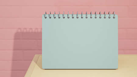 Blue calendar mock-up on yellow wooden table Placed in front pink brick wall pastel color.  Clipping path, 3d render. 免版税图像