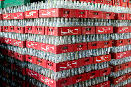 Group of Fanta returnable glass bottle in red Coca cola crate stacking in factory awaiting  a washing machine , Khon Kaen Province, Thailand. Photo taken at 8th of July 2011.