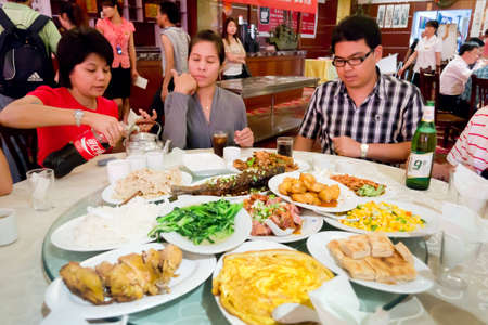 Group of Thai tourist eating Chinese food in Chinese restaurant at Xian, China.