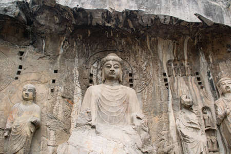 The Longmen Grottoes are located on both banks of the Yi River, near Luoyang City, Henan province, China.  Stock Photo