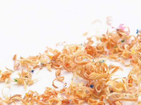 Pencil shavings By using a sharpener