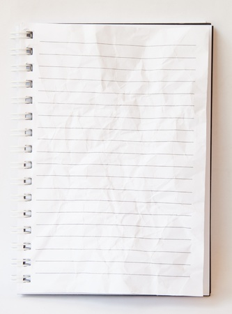 note book: White crumpled book on white background isolated.