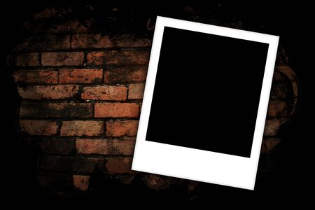 Photo frames on brick wall background  photo