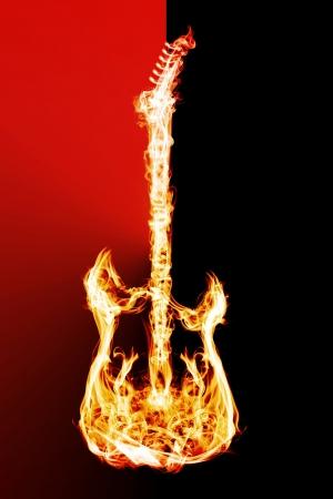 黒の背景に電子ギター炎