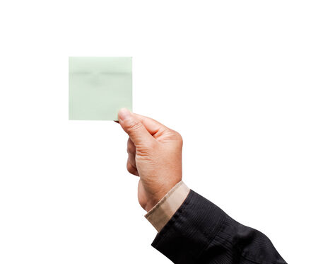 Businessman hand holding sticky note. photo
