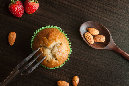 Banana cup cake on wooden background. Dessert Thai style. photo