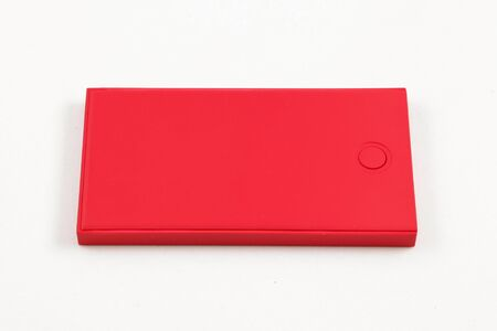 recharge: Red box squares. Small device electricity to recharge of smart phone. Stock Photo
