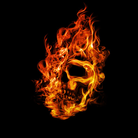 fire skull: Skull in flame on dark background. Stock Photo