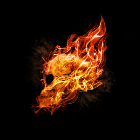 Skull in flame on dark background. Stock Photo
