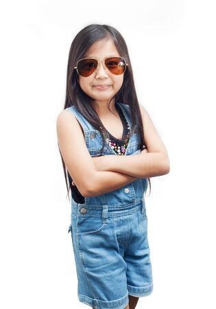 little girl posing: Little girl posing with arms crossed on white background.