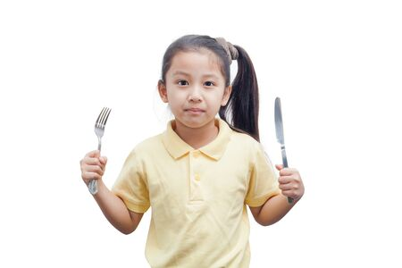 cute little girl: Little girl with  fork and knife over white background.