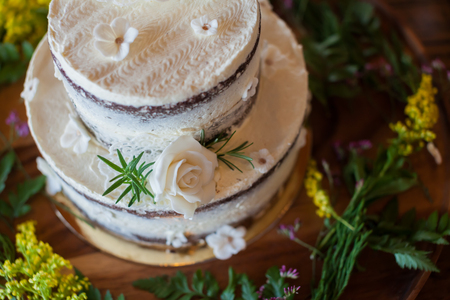 topper: Wedding cake with roses on top. Stock Photo