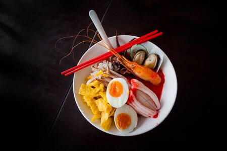 seafood soup: Noodles with seafood soup and red sauce, yong tau foo.