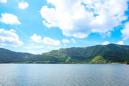 Lake and mountains view under blue sky in Japan. Stock Photo