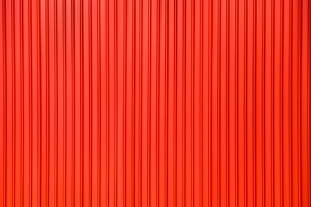 Red wavy grooved metal texture, copy space for background.