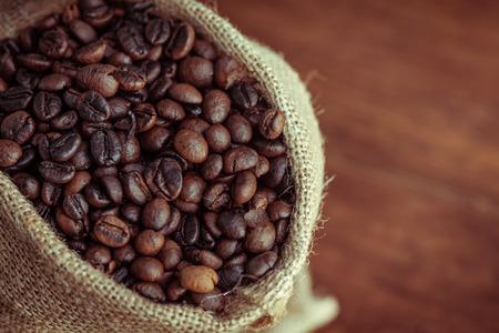 Roasted coffee beans in sacks