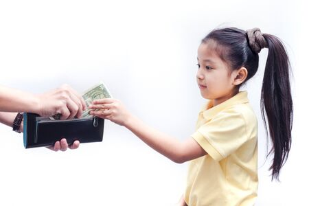 Parent pulls out money from wallet to little girl, on white background.