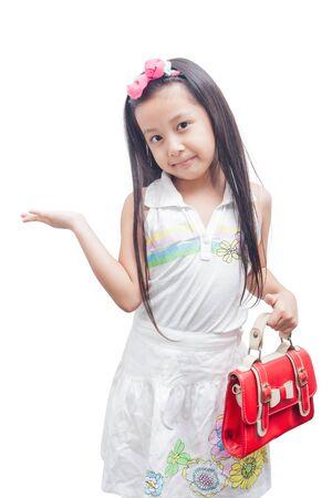 Little girl in white dress as fashion model over white background.