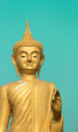 Buddha on a green background. Stock Photo