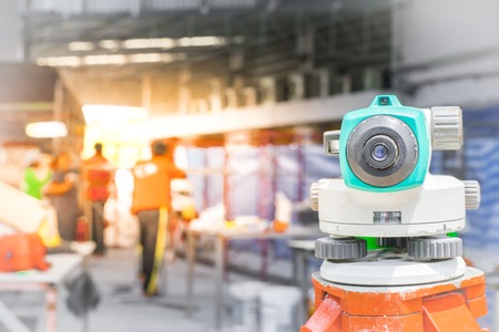 theodolite: Surveyor in construction with workers of the industry.  using the wallpapers or background. Use the project image build a house