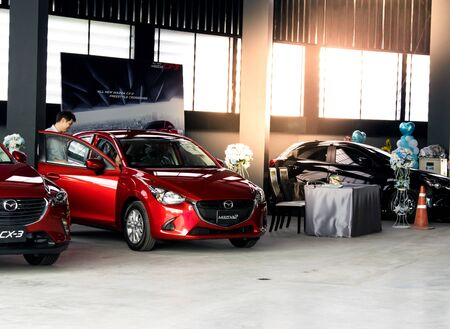 garage: BANGSAN, THAILAND - September , 2017 : Red car mazda brand japan parked in the showroom in Thailand for customers.