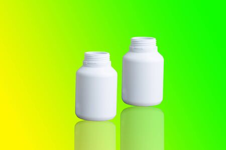 Bottle drug made to plastic on isolated background.Using wallpaper for package or product, drug image and copy space