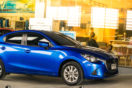 keyless: BANGSAN, THAILAND - OCTOBER, 13, 2017 :  car mazda brand japan blue color parked in showroom of thailand for customers. Editorial