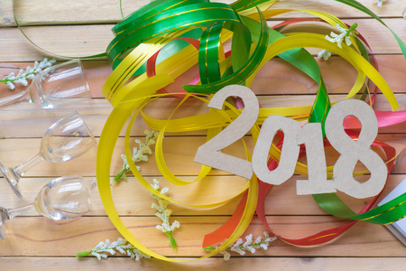 Notepad with number paper 2018 and ribbon on wood background. Using wallpaper or background. for happy new year image. And welcome new year photo.