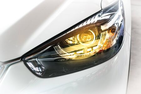 keyless: Led headlight car for customers. Using wallpaper or background for transport and automotive image. Stock Photo
