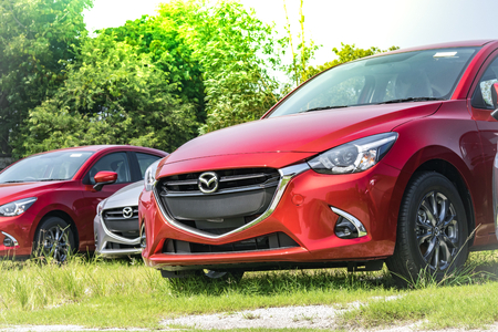 keyless: BANGSAN, THAILAND - OCTOBER, 13, 2017 :  This car  mazda 2 brand japan red color parked car stock in showroom of thailand for customers. Editorial