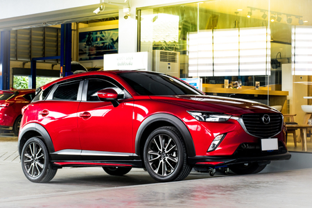 keyless: BANGSAN, THAILAND - OCTOBER, 27, 2017 :  This car cx 3 mazda brand japan red color parked in showroom of thailand for customers.
