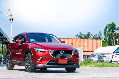 keyless: BANGSAN, THAILAND - OCTOBER, 29, 2017 :  Test drive car mazda cx 3 brand japan parked on lawn with tree blurry background in showroom of thailand for customers.