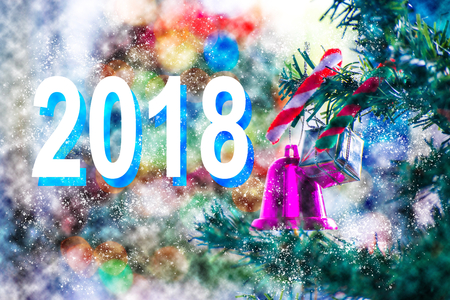Christmas tree with leaf christmas and gift box, number 2018 on tree bokeh background. Using wallpaper or background for happy new year 2018 image.