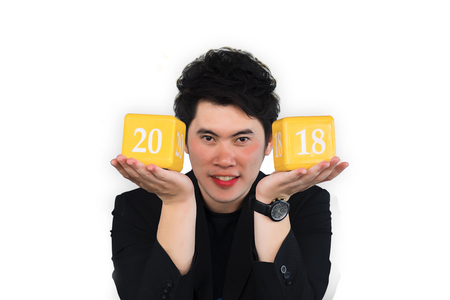 Asian man with box number 2018 for happy new year image.To the transport, automotive and everyone on isolated background.  Using life insurance or Health, business welcome new year photo.