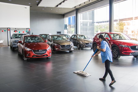 BANGSAN, THAILAND -JANUARY 4, 2018:Women are cleaning the floor in showroom car mazda brand of thailand for transport editorial image.