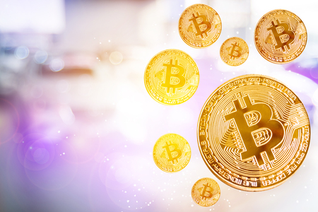 bit coin in blurry office background. For business people, finance, lifestyle, ethereum or block chain tecnology and professional image. Stock Photo