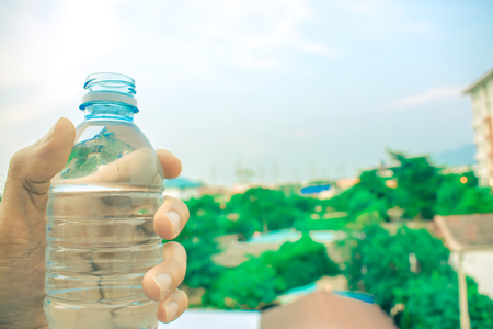 A bottle on sky and tree blurry background. Wallpaper for package or product, refreshing image and copy space Stock Photo