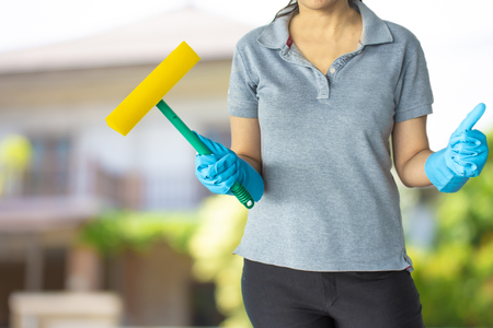 Female cleaning staff in home or bathroom blurry background Metaphor for cleaning Get rid of germs In bathroom, home office.For reliability And satisfaction of service and customers.