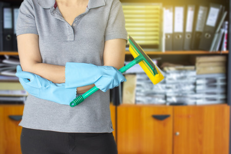 Female cleaning staff in room office or bathroom blurry background Metaphor for cleaning Get rid of germs In bathroom, home office.For reliability And satisfaction of service and customers. 版權商用圖片