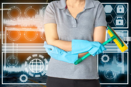 Female cleaning staff in bathroomin technology blue room lab cleaning Get rid of germs In bathroom, home office.For reliability Andsatisfaction of service and customers.