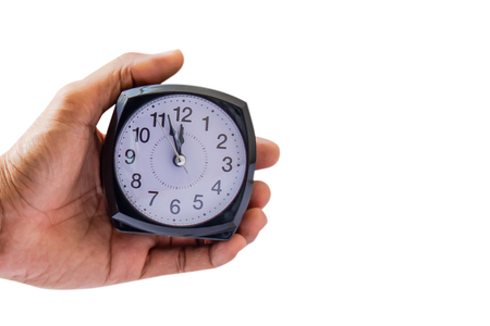 Holding clock on isolated background The time 12:00 am or pm and noon or midnight for made clock isolated or White background Copy space move to clipping path 写真素材