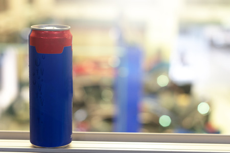 Blue can    drinks to refresh on blurred background For advertising of drinks image