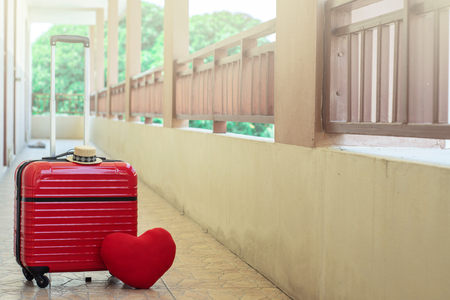Red luggage with red heart on blurred for activity lifestyle outdoors freedom or travel tourism and inspiration backpacker alone tourist image