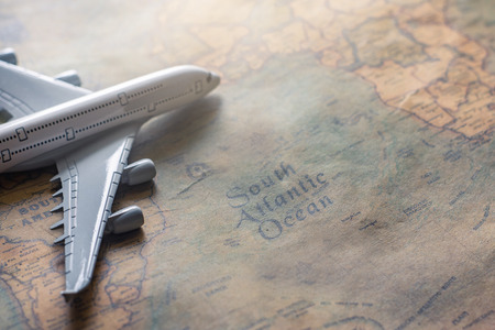 Airplane on paper map for travel adventure discovery image Stock Photo