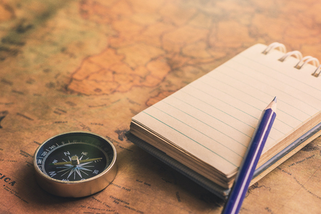 Notepad for note with pencil, compass on paper map for travel adventure discovery image