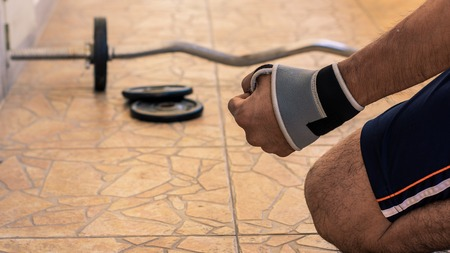 man Bodybuilder wait exercises with barbell weights power handsome athletic exercises.Metaphor Fitness and workout concept exercise Health lifestyle muscle health Stock Photo