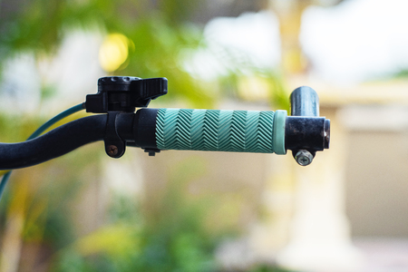 Close up hand brake mountain bike handle caliper bicycle blurred tree background for Exercise for health image Stockfoto