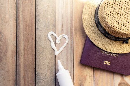 passport with hat and sun block cream for travel adventure discovery image